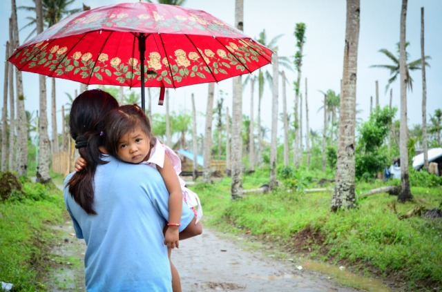 "TYPHOONHAIYAN Joy and her 2-year-old daughter Kimberly are on the pathway to recovery after their family was walloped by Typhoon Haiyan. Summary: Tonight, for the first time in months, 7-year-old Joel Jan is eating supper after 6pm. Later, he'll be able to pull out a book, and his mom, Joy, will read to him and his two younger sisters. ""Finally we have light at home,"" says Joy, 35. Today, World Vision has provided them with a solar lamp."