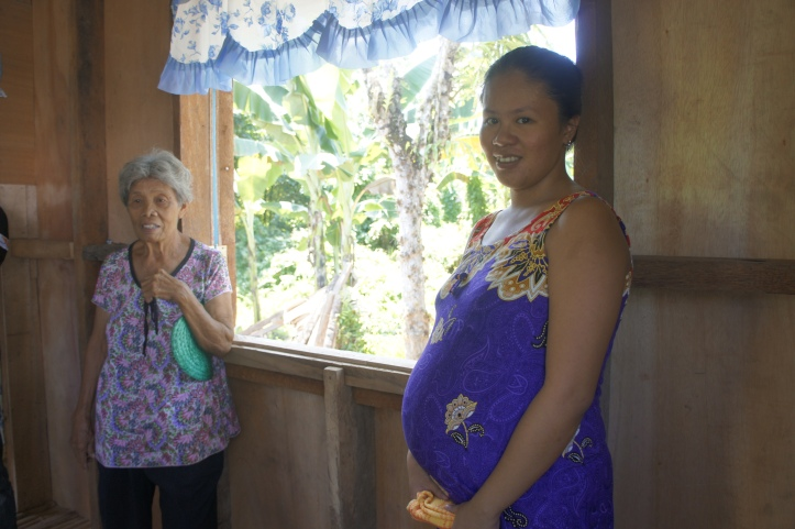 Ma Yung Ha Chae, 21, and her grandmother Trinidad Quintana, Victory, Dulag, Leyte, Philippines